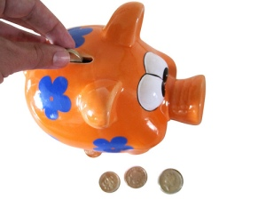 Putting money in a piggy bank
